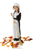 Pilgrim Girl Raking Stock Photography