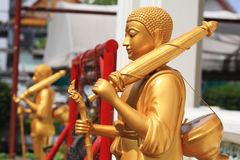 Pilgrim Golden Buddha statues Royalty Free Stock Images