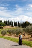 Pilgrim on her way. In tuscany italy Stock Photo