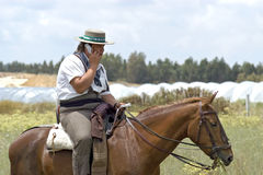Pilgrim, horseman, on his way to El Rocio. Spain, province Huelva, Andalusia region: pilgrim on his way to the pilgrims church in El Rocio. The man riding a royalty free stock images