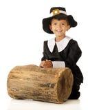 A Pilgrim Kneeling to Pray Royalty Free Stock Photos