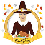 Pilgrim man holding a roasted turkey behind gold ribbon with happy thanksgiving text Royalty Free Stock Image