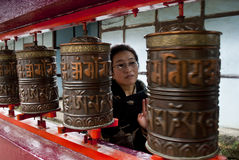 Pilgrim moving prayer wheels Stock Images