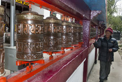 Pilgrim moving prayer wheels Stock Image