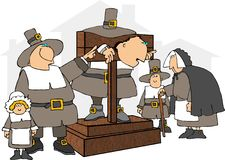 Pilgrim in a pillory Royalty Free Stock Photos