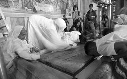 Pilgrim, Prayers In the Holy Sepulchre Church-the marble slab. 