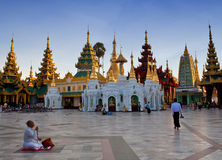 Pilgrim praying at golden Shwedagon Pagoda in Yangon, Myanmar Stock Images