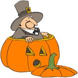 Pilgrim In A Pumpkin Stock Photos