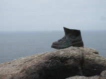 The Pilgrim's boot. Finisterre's Lighthouse, in Galicia, Spain. Is a monument for the last track of the Camino of Santiago Royalty Free Stock Photography
