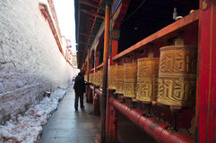 Pilgrim turning Prayer Wheels in Ramoche Temple Royalty Free Stock Images