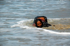 Pilgrim Washes the Sins. Unidentified lady pilgrim washes her sins in the waters of the Indian ocean near Colva in the state of Goa on the 24th of November, 2007 Stock Photos