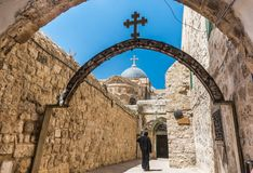 A pilgrim wearing black robe, and walking into St. Anthony Coptic Monastery