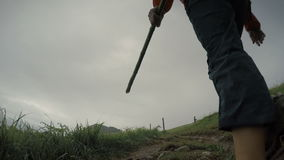 Pilgrim woman walks by the Camino, the popular trekking route in the rainy season stock footage