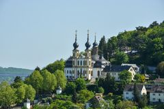 The pilgrimage church Kaeppele on a hill in Wuerzburg on a sunny. The pilgrimage church Kaeppele on a hill in Wuerzburg through the trees on a sunny day Stock Images