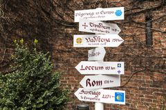 Pilgrimage routes. Hamburg, Germany. Directions sign post with European pilgrimage routes as the Camino de Santiago Way of St James and Pilegrimsleden St. Olav`s Royalty Free Stock Photo