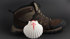 Pilgrimage. Shell next to the boot, symbol of pilgrimage Stock Photography