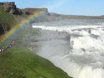 Pilgrimage to Gullfoss, Iceland. More and more people visit beautiful Iceland, pilgrimage to waterfall Gullfoss, under the rainbow Stock Photo