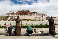 Pilgrimage to the Potala Palace. Tibetans in the Potala Palace before the pious worship Stock Image