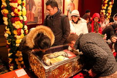Pilgrimage to the relics of Saint Dimitrie the New. People praying at the relics of Saint Dimitrie the New source of mir at the Romanian Patriarchate on the hill Stock Photos