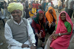 PILGRIMS. A group of pilgrims relaxing at a temporary shelter at the halting camp toward Gangasagar fair Stock Images