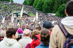 Catholic pilgrims gathering to celebrate the Pentecost. Pilgrims from all over the world gather to celebrate the Pentecost catholic tradition on May 2012 in royalty free stock photography