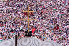 Catholic pilgrims gathering to celebrate the Pentecost. Pilgrims from all over the world gather to celebrate the Pentecost catholic tradition on May 2018 in stock photography