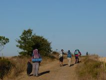 Pilgrims along the way of St. James. People walking on Camino de Santiago. Royalty Free Stock Images