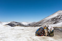 Pilgrims backpack with snow mountain Stock Photo