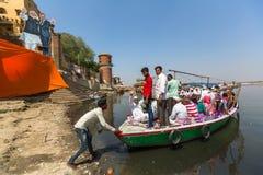Pilgrims on the banks of Holy Ganga river. Varanasi. Royalty Free Stock Photos