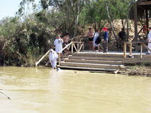 Pilgrims are baptized in the Jordan River Stock Photo