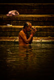 Pilgrims bathe and wash in the holy waters of the Ganges, Varana Royalty Free Stock Image
