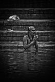 Pilgrims bathe and wash in the holy waters of the Ganges, Varana Stock Image