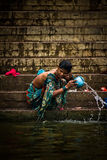 Pilgrims bathe and wash in the holy waters of the Ganges, Varana Royalty Free Stock Photo