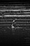 Pilgrims bathe and wash in the holy waters of the Ganges, Varana Stock Photo