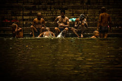 Pilgrims bathe and wash in the holy waters of the Ganges, Varana Royalty Free Stock Images