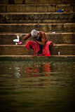 A Pilgrims bathes and wash in the holy waters of the Ganges, Varana Stock Image