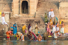 Pilgrims Bathing in the Ganges River in Varanasi, Uttar Pradesh,. Hindu pilgrims bathing in the sacred Ganges river on February 19, 2013, in Varanasi, Uttar Stock Image