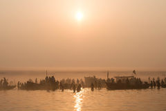 Pilgrims Bathing in the Ganges at Sunrise, Varanasi, India Stock Image