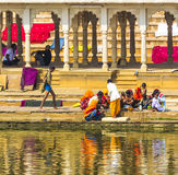 Pilgrims at a Bathing Ghat at Pushkar's Holy Lake Royalty Free Stock Photo