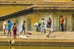 Pilgrims at a Bathing Ghat at Pushkar's Holy Lake Stock Image