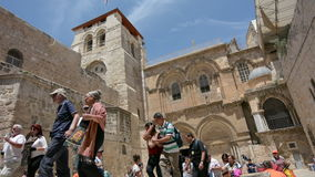 Pilgrims at the CChurch of the Resurrection in Jerusalem, Israel. stock video footage