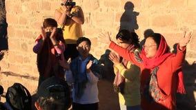 Pilgrims from China. Invocatory prayer. Moses Mountain. Sinai Peninsula. Egypt Stock Image