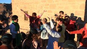 Pilgrims from China. Invocatory prayer. Moses Mountain. Sinai Peninsula. Egypt Stock Photo