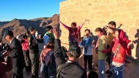 Pilgrims from China. Invocatory prayer. Moses Mountain. Sinai Peninsula. Egypt Stock Photos
