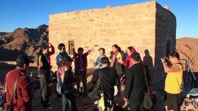 Pilgrims from China. Invocatory prayer. Moses Mountain. Sinai Peninsula. Egypt Royalty Free Stock Image