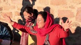 Pilgrims from China. Invocatory prayer. Moses Mountain. Sinai Peninsula. Egypt Royalty Free Stock Photo