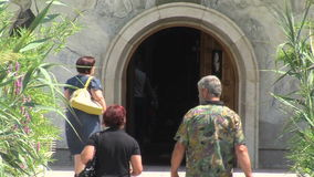 The pilgrims come to the church of St. Petka in Rupite, Bulgaria stock video