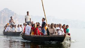 Pilgrims Crossing river Ganga by boats Stock Photography