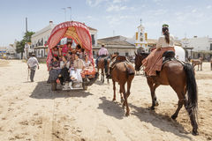 Pilgrims with a donkey cart in El Rocio, Spain Royalty Free Stock Photos