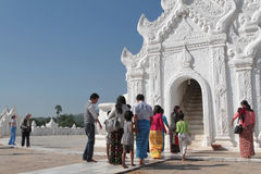 Pilgrims at the entrance of the white pagoda Royalty Free Stock Photos